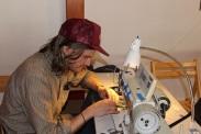 man sewing at machine